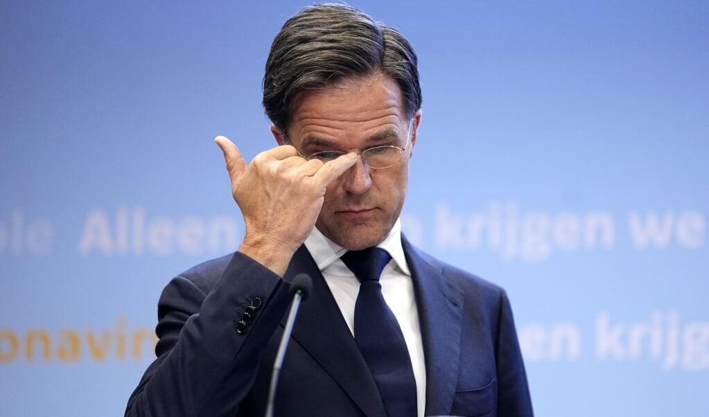 Demissionair premier Mark Rutte tijdens een persconferentie over het coronavirus.  (beeld anp / Phil Nijhuis)