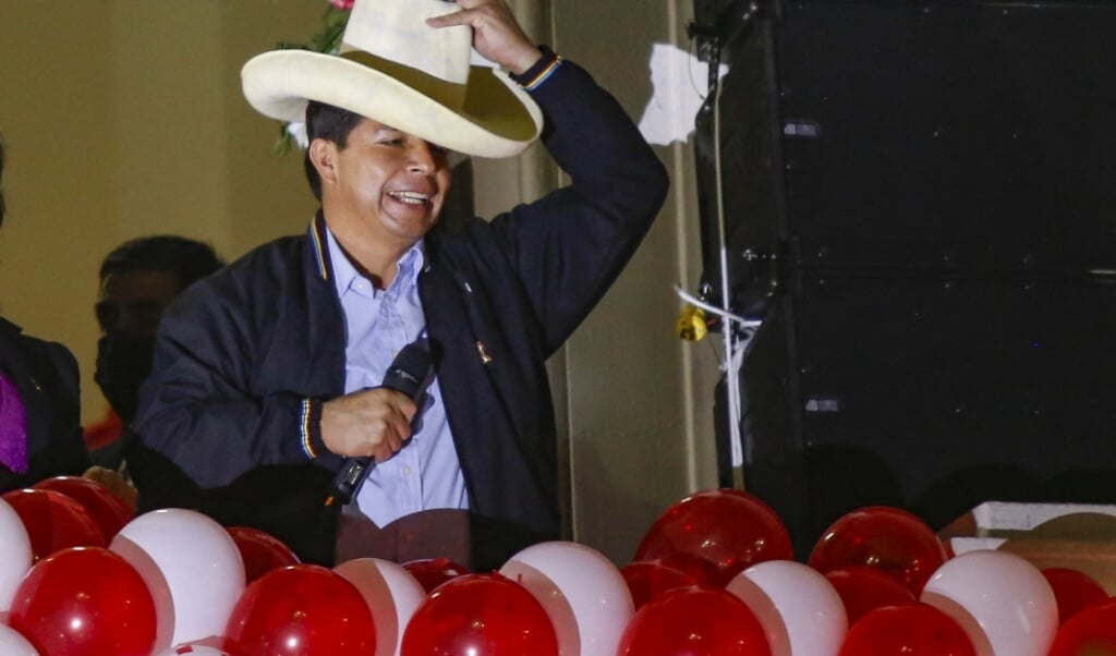 2021-07-24 22:42:20 Peruvian President-elect Pedro Castillo gestures during a celebration at the Peru Libre headquarters, following the ceremony in which he received his credentials for the 2021-2026 period in Lima, on July 23, 2021. Castillo said he is going to copy foreign