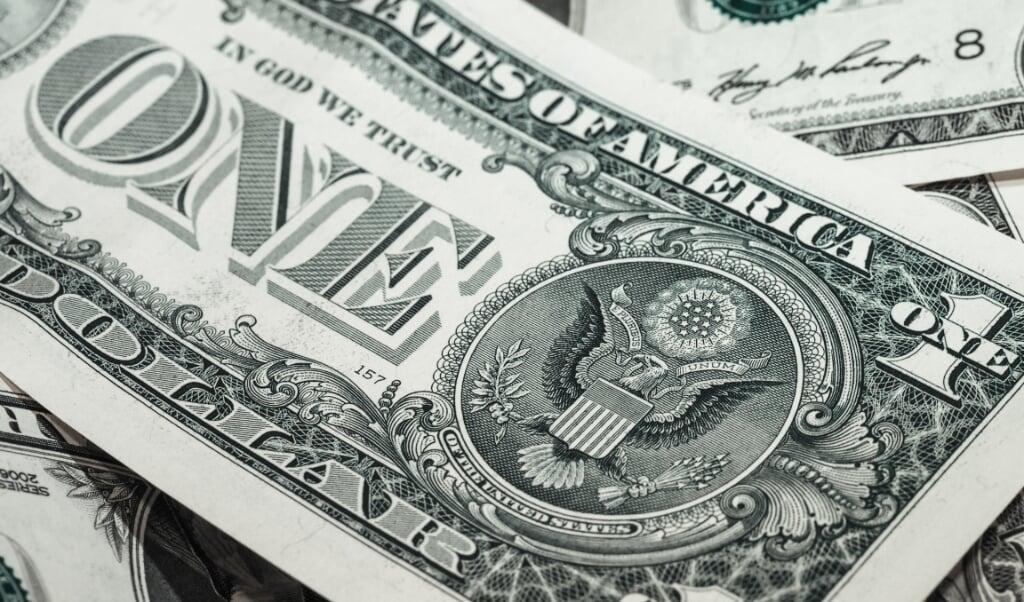 Een Amerikaans bankbiljet met het motto 'In God We Trust'.  (beeld pixapay)