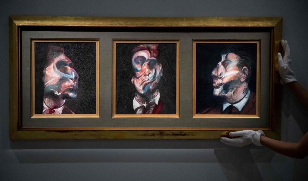Portret van George Dyer. Door gezichten te vervormen, kon Bacon het innerlijk weergeven.   (beeld afp / Chris J. Ratcliffe)