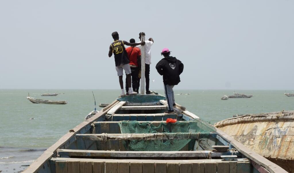 Afrikaanse jongens die naar de Caribische eilanden willen.  (beeld Lex Rietman)