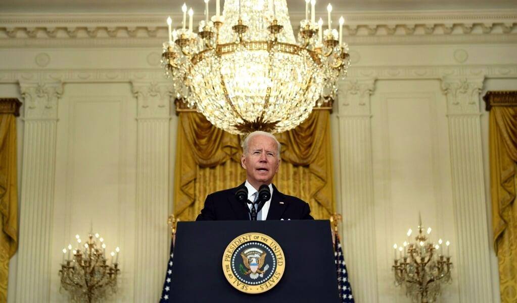 President Biden zegde toe dat de VS de Afghaanse bevolking zal bijstaan, maar niet met een 'eindeloos militair ingrijpen'. Als Amerikaans personeel in Afghanistan wordt aangevallen, zal de VS 'snel en krachtig' reageren.  (beeld afp / Brendan Smialowski)