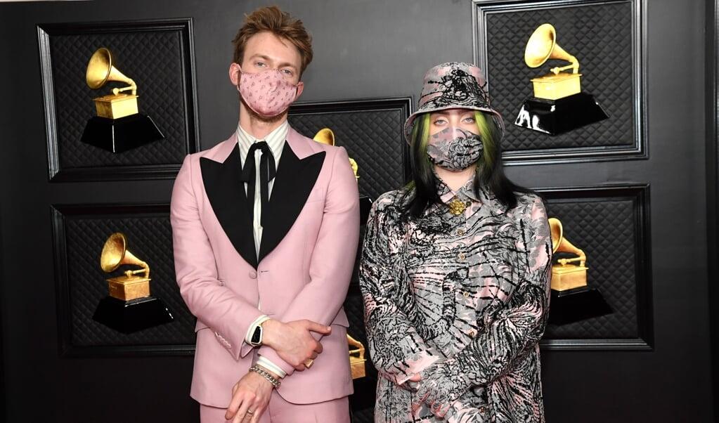Billie Eilish (hier nog met de bekende groene lokken) en broer Finneas sleepten samen al diverse prijzen in de wacht met Billies vorige album.   (beeld epa/ Kevin Mazur)
