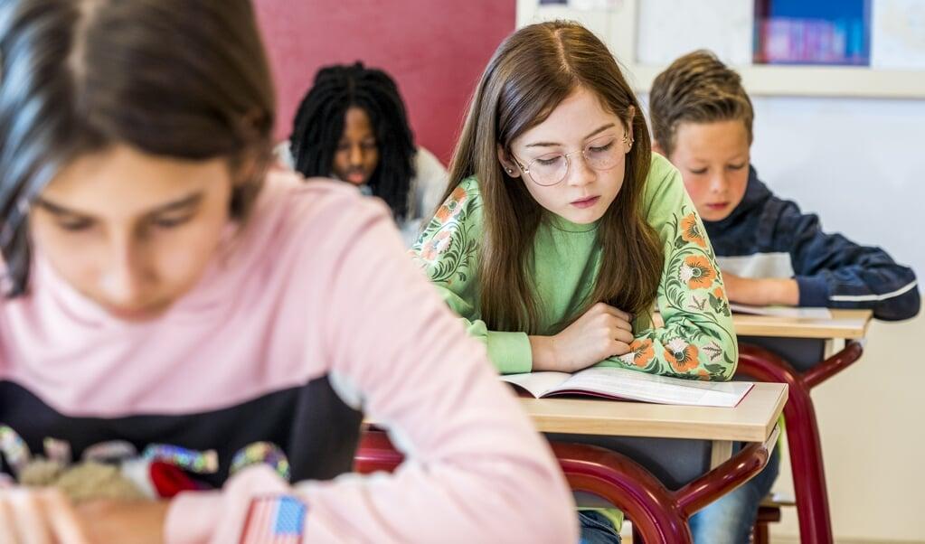 Leerlingen van groep 8 van De Regenboog in Leiderdorp, geen 10-14-school.  (beeld anp / Lex van Lieshout)