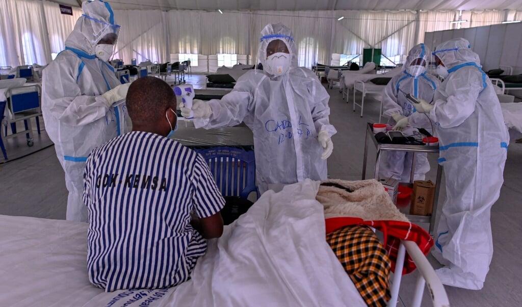 Scenario 3 op de schaal van 5 scenario's in de strijd tegen de coronapandemie houdt in: 'externe dreiging'. In dit scenario is het virus in Nederland en de meeste welvarende landen onder controle, maar in andere landen tiert het virus welig en ontstaan nieuwe gevaarlijke varianten.  (beeld afp)