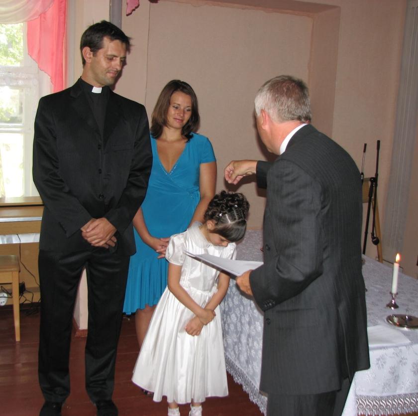 Doop van 13 kinderen bij overgang van baptisten