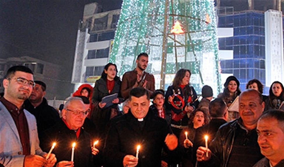 Kardinaal Sako (midden) bij eerdere kerstactiviteiten in Bagdad.   (afp / Sabah Arar)