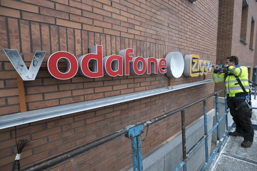 Het logo van telecombedrijf Vodafone en kabelaar Ziggo.  (anp / Marcel van Hoorn)