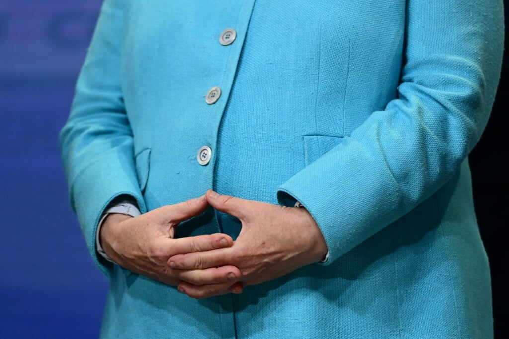 2021-09-26 19:53:51 German Chancellor Angela Merkel forms her typical hand gesture, the so-called