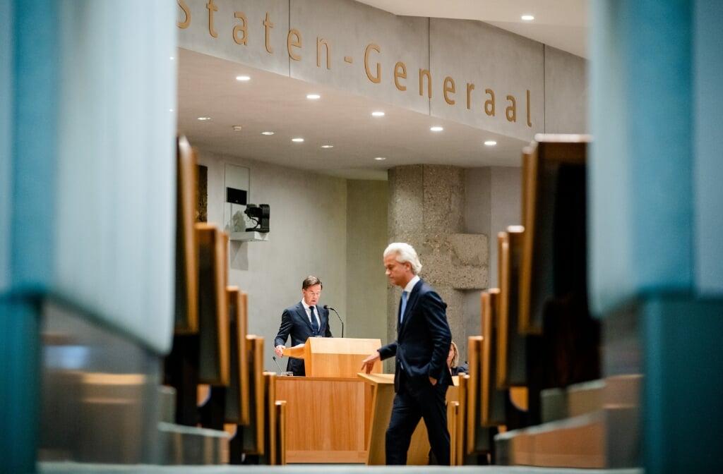 2021-09-23 12:41:58 DEN HAAG - Demissionair premier Mark Rutte en Geert Wilders (PVV) tijdens de tweede dag van de Algemene Politieke Beschouwingen, het debat na de Troonrede op Prinsjesdag. Na de reactie van de Tweede Kamer op de begroting die op Prinsjesdag door het demissionaire kabinet is gepresenteerd, was het de beurt aan Rutte om te reageren. ANP BART MAAT  (beeld anp / Bart Maat)