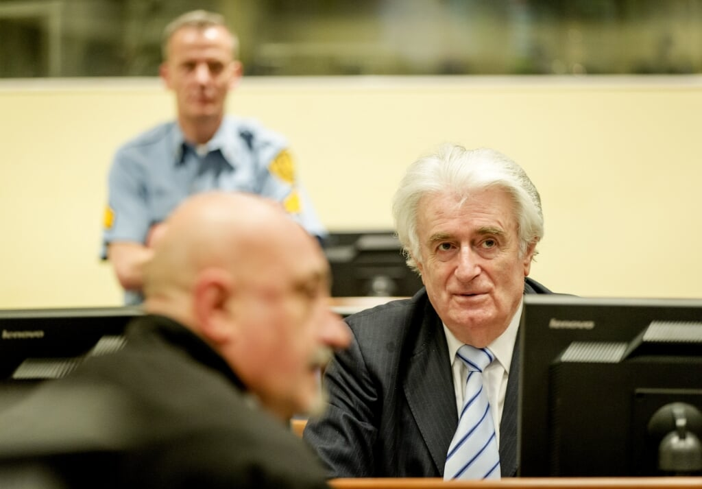 2016-03-24 13:46:36 THE HAGUE - Bosnian Serb wartime leader Radovan Karadzic in the courtroom for the reading of his verdict at the International Criminal Tribunal for Former Yugoslavia (ICTY) in The Hague, The Netherlands.The former Bosnian-Serbs leader is indicted for genocide, crimes against humanity, and war crimes. Karadzic is considered the main responsible for the Srebrenica. ANP POOL ROBIN VAN LONKHUIJSEN  (beeld anp / Pool Robin van Lonkhuijsen)