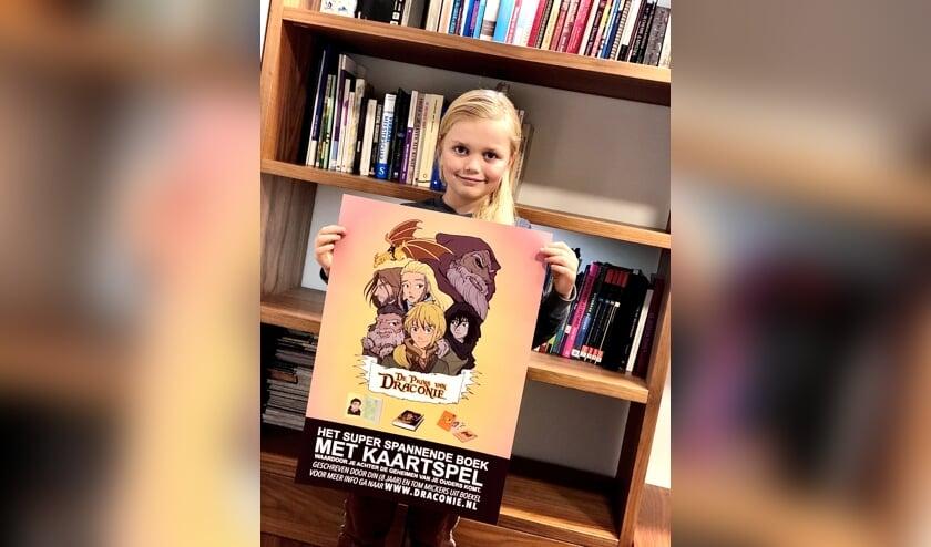 De 8-jarige Din Mickers schreef mee aan het boek.