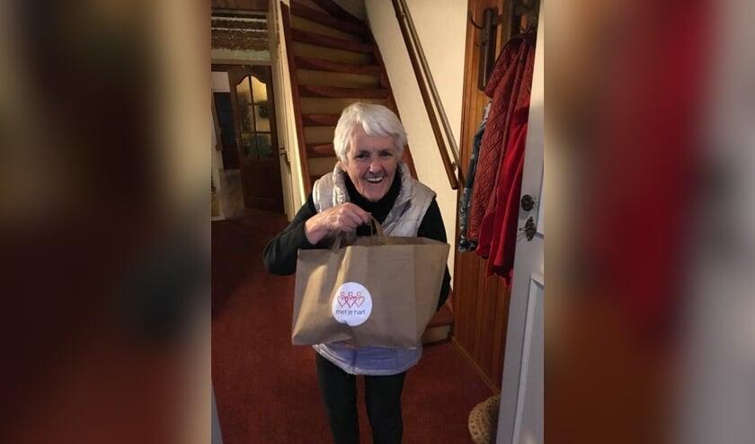 Annie Gevers met een EET met je hart tas.