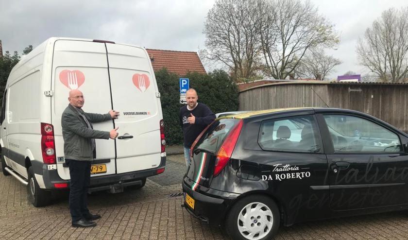 Jan Janssen (Voedselbank Veghel) met Robert Wallet (Trattoria da Roberto).