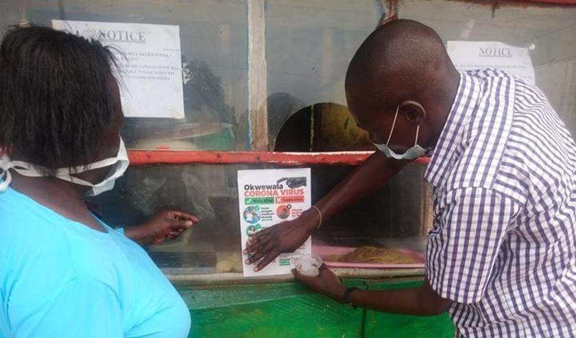 Oegandese poster met informatie over het Corona-virus