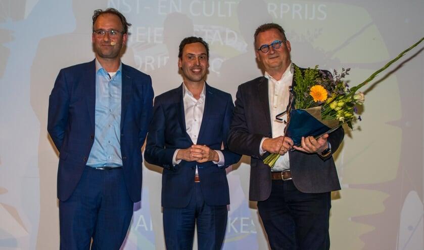 <p>Marc van Kessel (R) won in de groep professionals.</p>