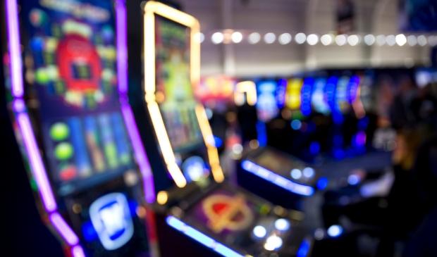 Blurred slot machines in a casino.