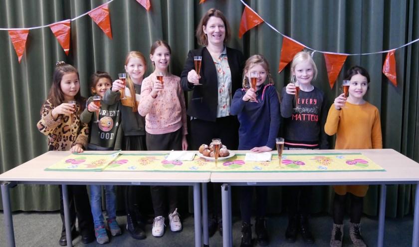 Een toast op het nieuwe jaar bij Harmonievereniging Barendrecht.
