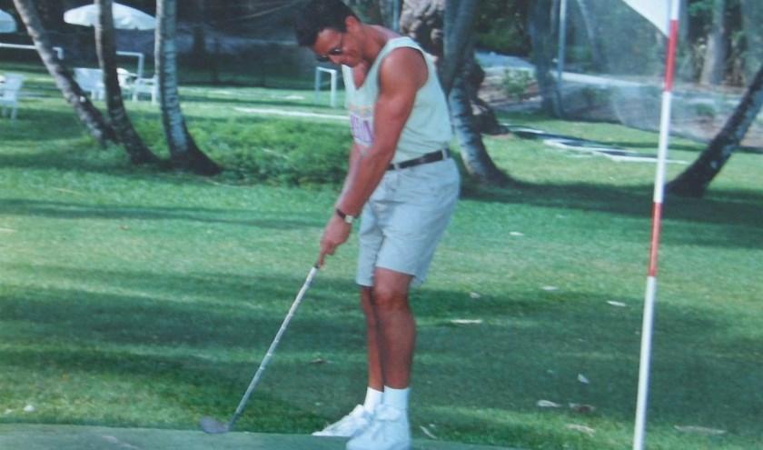 William Vat op de golfbaan.
