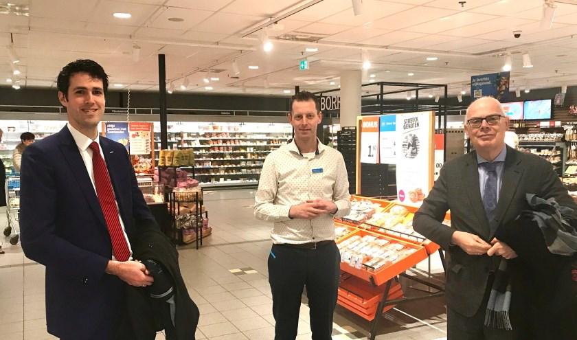 Wethouder Proos en  burgemeester Van Belzen bij de vestiging van Albert Heijn in Carnisselanden.