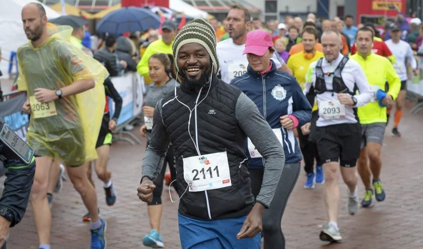 Ondanks het slechte weer tóch genieten van mooie sport; that's the spirit! (Foto: Wijntjesfotografie.nl)