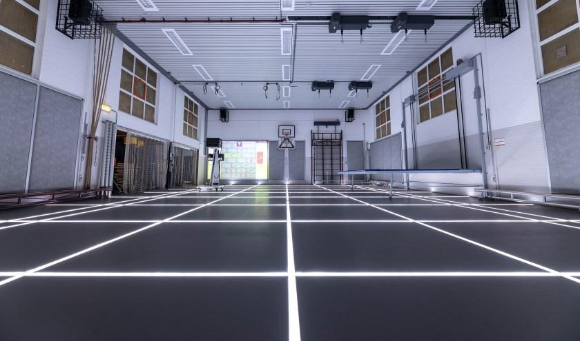 Gymzaal Klein Coolstraat heeft nu een ledvloer waarmee je belijning aan en uit kunt zetten.