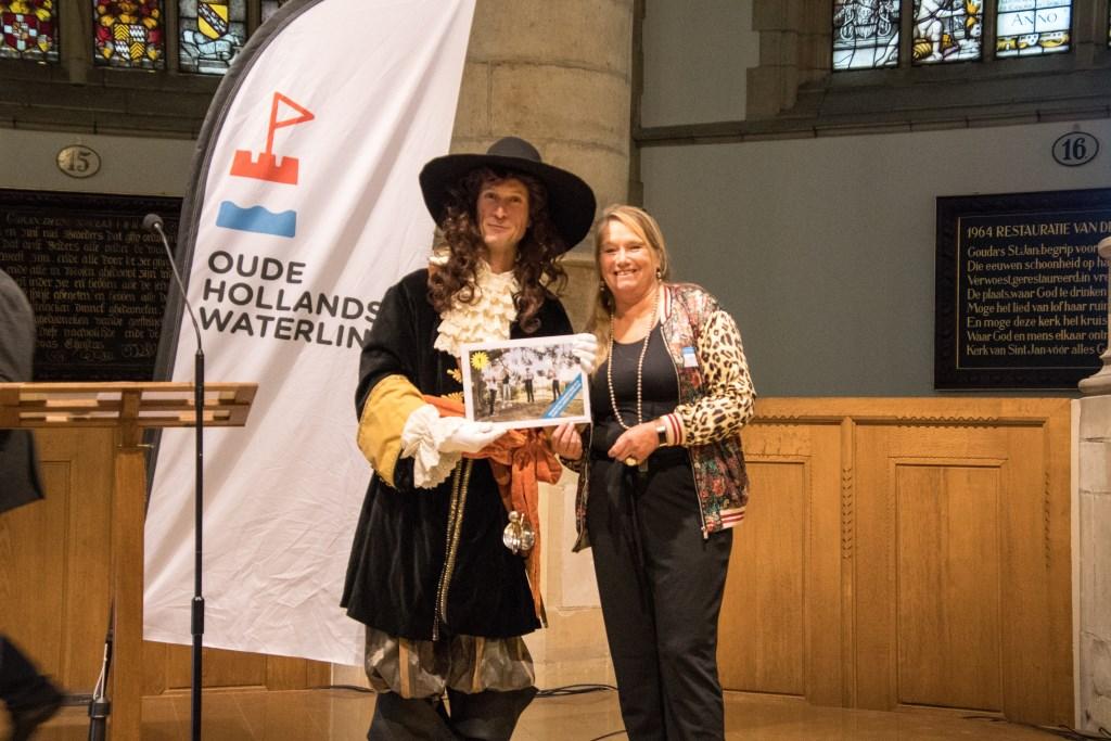 De prijsuitreiking van de fotoprijsvraag vond in de Goudse Sint Janskerk plaats.  Foto: Sjaak Loef © DPG Media