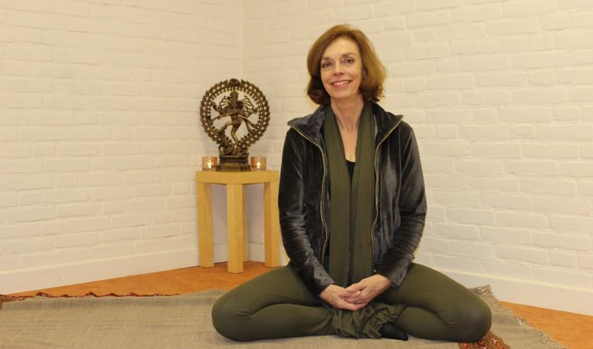 'Yoga is voor iedereen', zegt Carolyn van de Wijngaert. 'Ik vind het wel belangrijk dat het kleinschalig blijft, dat ik de mensen bij naam ken'
