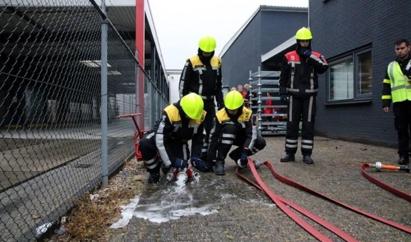 Jeugdbrandweer Herwijnen in actie tijdens de wedstrijd in Veenendaal