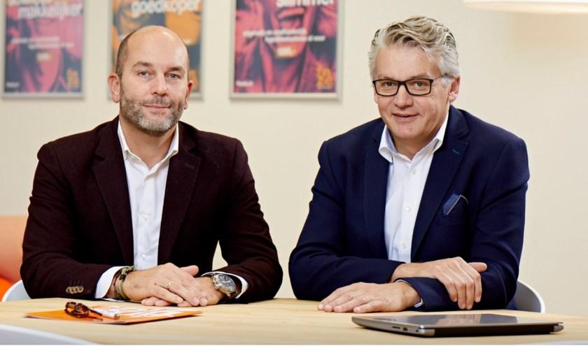 Robin Heuten (links) en Richard Boxtart van Finzie Enschede zijn van mening dat je niet kunt zeggen dat aflossen altijd goed is.
