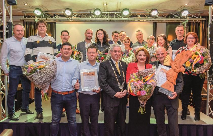 De hoofdrolspelers van de Duivense ondernemersverkiezingen van 2019 op het podium tijdens de nieuwjaarsreceptie van MKB Duiven.