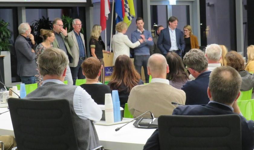 De verschillende werkgroepen beantwoorden vragen vanuit de zaal. Foto: Nik Mandemakers