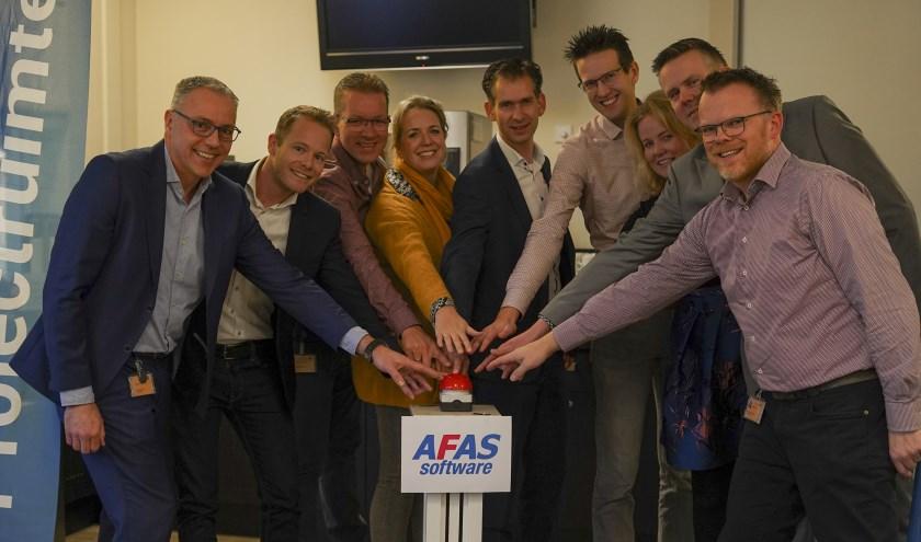 Met een symbolische druk op de rode knop is AFAS live in St Jansdal.
