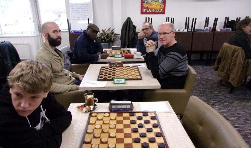 Links de Culemborgse spelers Simon Harmsma, Boudewijn Derkx en Jean Marc Ndjofang