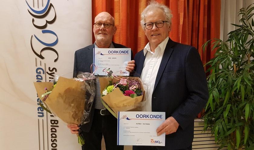 Jubilarissen Alfred Veltman en Wim Jansen.