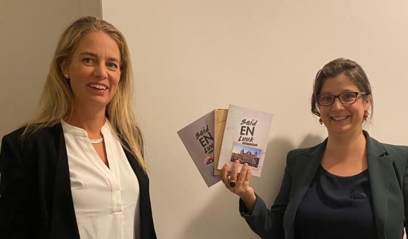 <p>Tamara Reesink van Branding en Meike Grol met de 3 boeken in haar hand over de avonturen van Said en Luuk.<br><br></p>