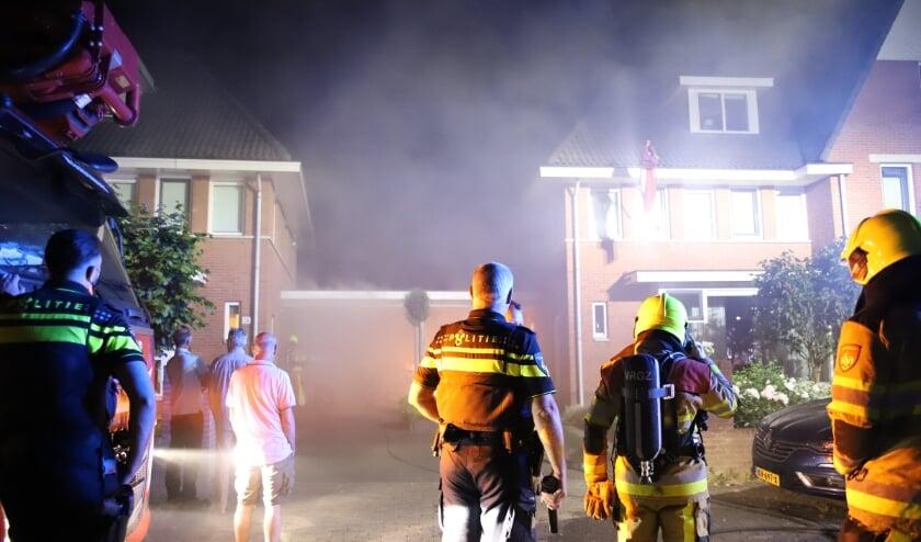 Flinke rook en roetschade bij brand in garage