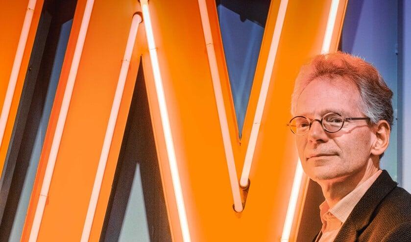<p>Paul van de Laar is stadshistoricus en inwoner en raakte vergroeid met Rotterdam. Foto: Jaap van Rijn</p>