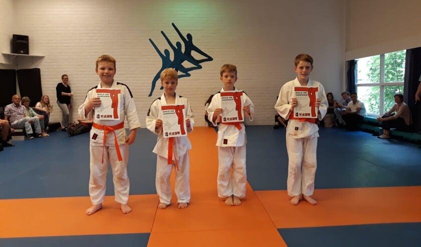 Vier trotse judoka's met hun oranje band. | Foto: PR