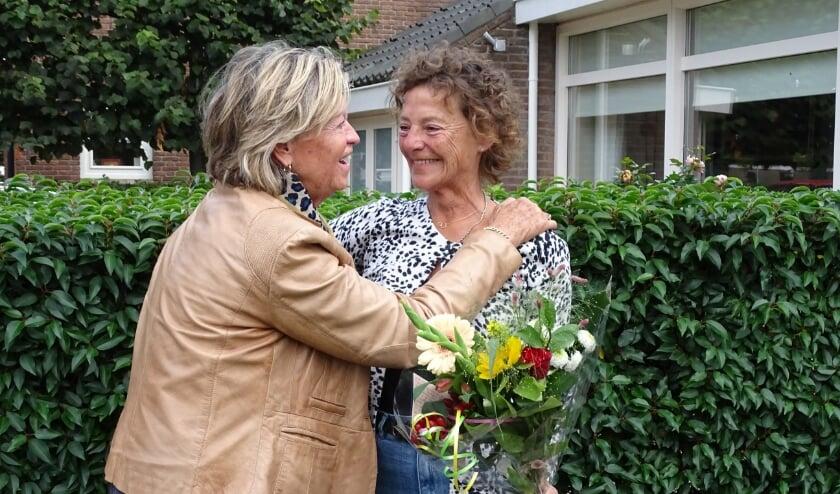 <p>Buren werden verrast door een bloemetje van... de buren.&nbsp;</p>