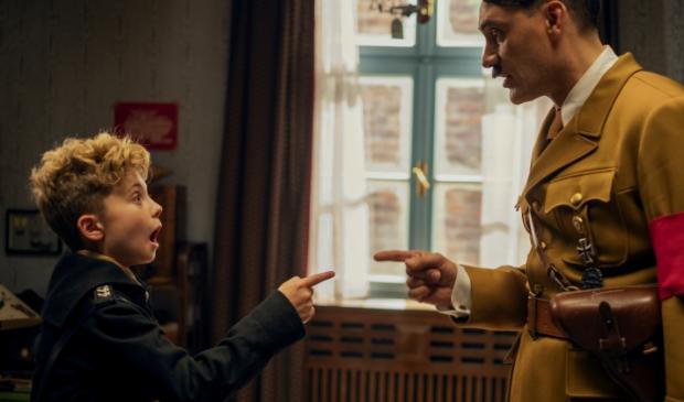 <p>Roman Griffin Davis and Taika Waititi in the film JOJO RABBIT.</p>