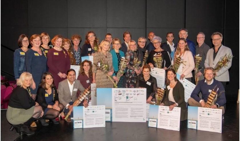 Vertegenwoordigers van zorgorganisaties, samenwerkend in Noordkop Gezond voor Elkaar.