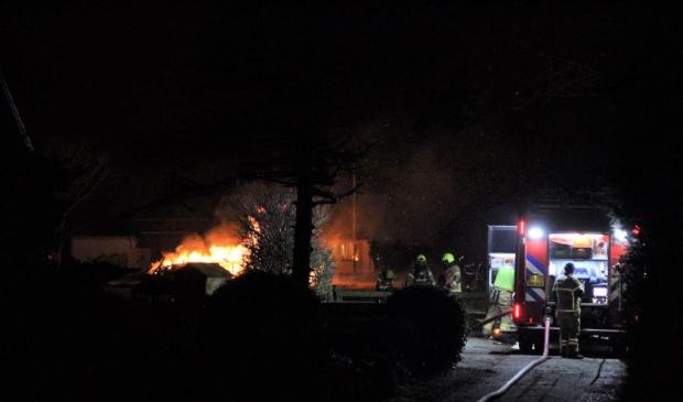 Brand in een afvalhoop buiten bij Texel Zoo.