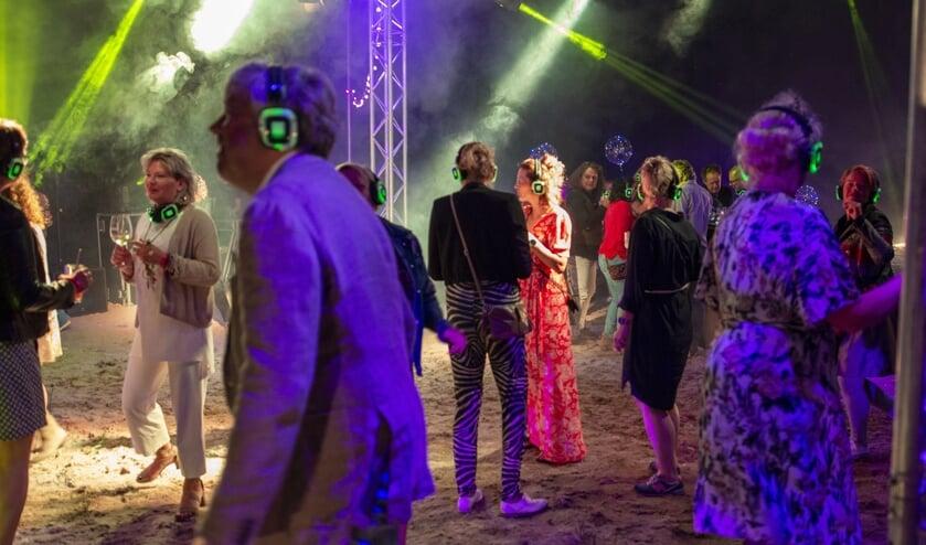 Ter afsluiting van het event was er een silent disco, iedereen een koptelefoon op om te genieten van de muziek. Foto: Marion Verhaaf